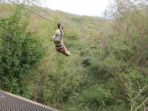 """Catherine Sweeney zip-lining near Mazatlan, Mexico"""