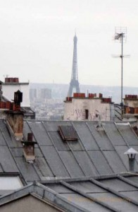 """View of the Eiffel Tower over the rooftops of Montmartre, Paris"""