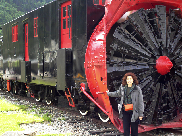 """Black and red train snowblower train of the While Pass & Yukon Railway in Skagway, Alaska"""""
