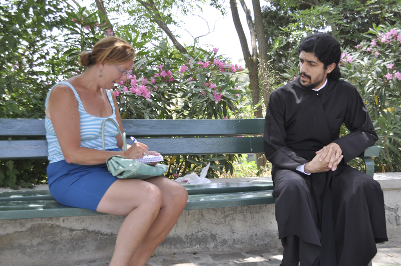 """Meg Pier interviewing a monk in Cypress"""