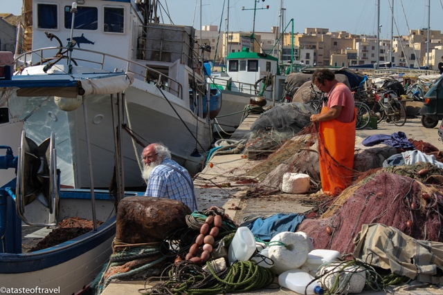 """The work starts after the boats return to Favignana's fishing port., Sicily"""