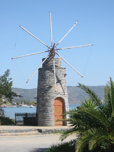 """Windmill near the harbor in Elounda on the Greek island of Crete"""