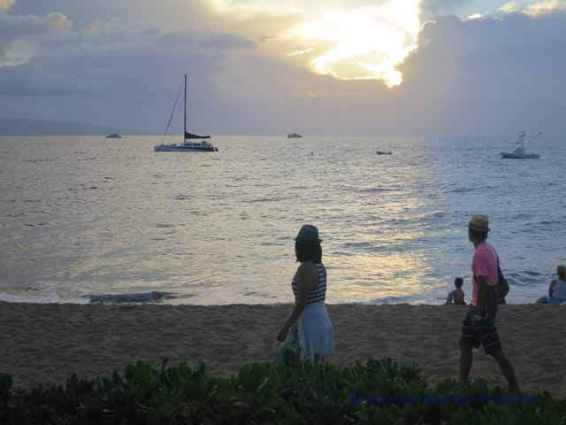 """People watching sunset and boats on the ocean at Ka'anapali Beach by the Westin Hotel"""