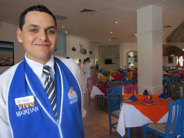 """Los Arcos waiter with smile Credit-Deborah Grossman"""