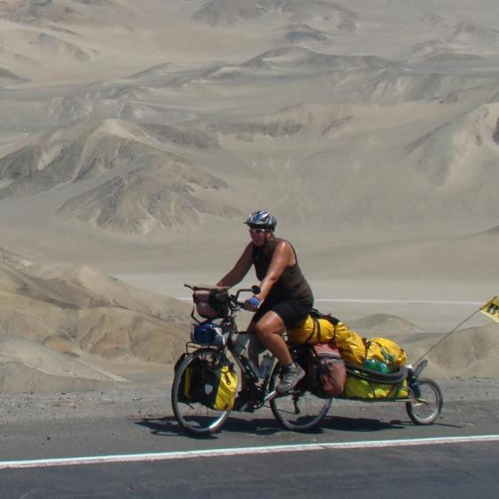 """Nancy Sthre-Vogel on her bike somewhere along the Peruvian coast"""