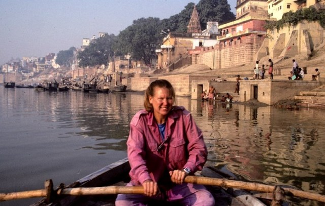 """Nancy Sathre-Vogel in a boat on the Ganges River"""