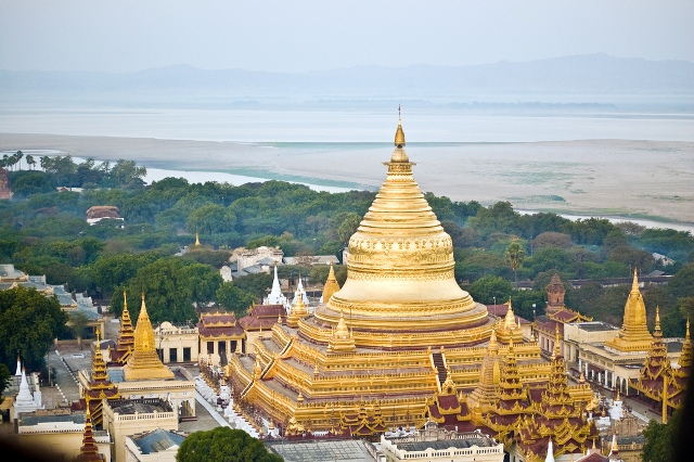 """In Myanmar, the Shwezigon Zedi with Irrawaddy River  in the backgroun"""