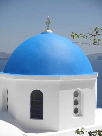 """Iconic blue steeple of church in Santorini"""