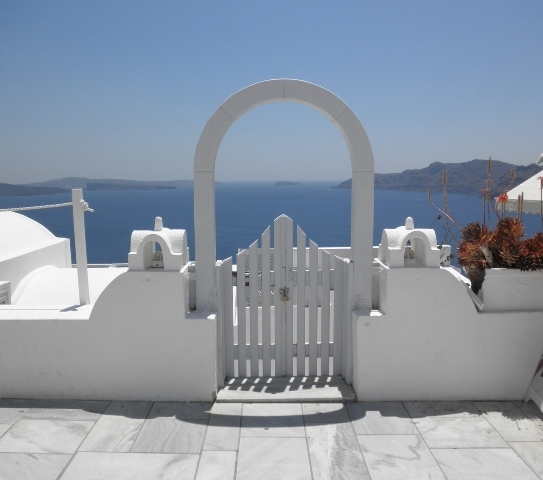 """Picture perfect gate in Oia, Santorini"""