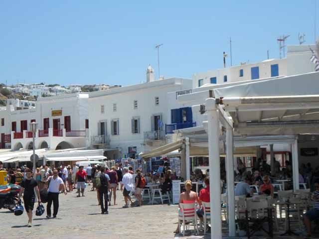 """Walking along the harbor in Mykonos toward Alegro Cafe"""