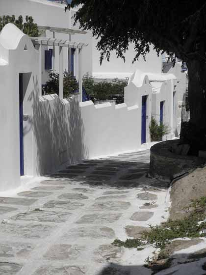 """Walking winding paths toward center of Mykonos"""