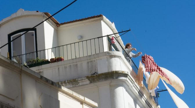 Laundry hanging from a balcony in Lisbon --- photo by Barbara Nelson